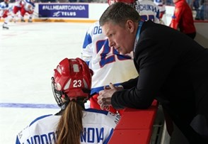 ST. CATHARINES, CANADA - JANUARY 8: Russia assistant coach Alexei Chistyakov has a conversation with Elena Vodopyanova #23 during warm up prior to preliminary round action against Canada at the 2016 IIHF Ice Hockey U18 Women's World Championship. (Photo by Jana Chytilova/HHOF-IIHF Images)