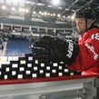 ST. CATHARINES, CANADA - JANUARY 09: Switzerland's Kaleigh Quennec #18 prepares to knock down a stack of pucks in the warmup prior to preliminary round action against Team Finland at the 2016 IIHF Ice Hockey U18 Women's World Championship. (Photo by Francois Laplante/HHOF-IIHF Images)
