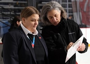 ST. CATHARINES, CANADA - JANUARY 12: Switzerland assistant coach Margot Page shows head coach Andrea Kroni a play she drew up piror to relegation round action against France at the 2016 IIHF Ice Hockey U18 Women's World Championship. (Photo by Jana Chytilova/HHOF-IIHF Images)