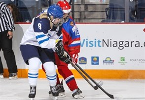 ST. CATHARINES, CANADA - JANUARY 12: Finland's Petra Nieminen #9 battles for the puck with Russia's Yekaterina Likhachyova #19 during quarterfinal round action at the 2016 IIHF Ice Hockey U18 Women's World Championship. (Photo by Francois Laplante/HHOF-IIHF Images)