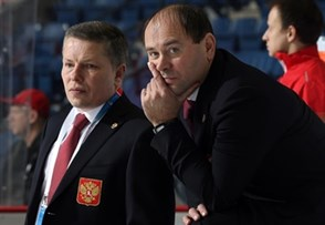 ST. CATHARINES, CANADA - JANUARY 15: Russia head coach Alexander Ulyankio and assistant coach Alexei Chistyakov look on during the warm-up prior to bronze medal game action against Sweden at the 2016 IIHF Ice Hockey U18 Women's World Championship. (Photo by Jana Chytilova/HHOF-IIHF Images)