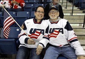 ST. CATHARINES, CANADA - JANUARY 15: USA fans getting set to cheer on their team against Canada in gold medal game action at the 2016 IIHF Ice Hockey U18 Women's World Championship. (Photo by Jana Chytilova/HHOF-IIHF Images)